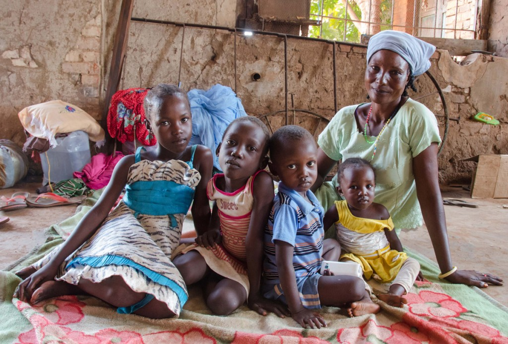 Forty-year-old Elizabeth fled Wau on June 24 at the height of the shooting in the town, walking all night in the rain with her five children aged six months to seven years. She returned to the town five days later to find her house had been looted. Her youngest child fell sick and is being treated at a Wau hospital. RICHARD NIELD/AL JAZEERA