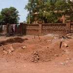 At least 13 civilians killed in the attacks on Wau were buried in the grounds of St Mary's Cathedral. Bodies were buried two to a grave. Many of the bodies were recovered, already rotting, from a Wau hospital by a priest at the cathedral, Father Natale, and other church workers. The church had not previously been used for burials. RICHARD NIELD/AL JAZEERA