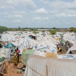 In just 10 days, more than 19,700 people were displaced to a site next to the UNMISS peacekeeping base. RICHARD NIELD/AL JAZEERA